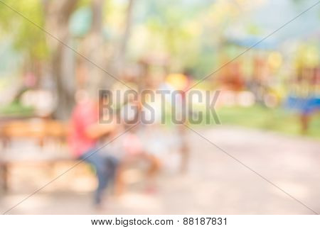 Blur Background Image Of People Activities In Public Park With Bokeh.