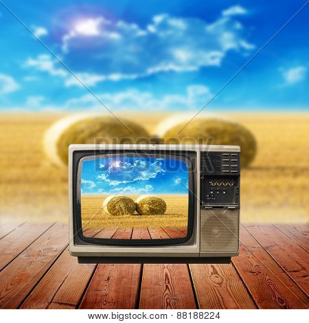 Hay Bail Harvesting In Golden Field And Sunset In Television