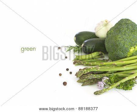 Fresh green vegetables  on white