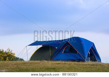 Tourists Blue Tent On Mountain