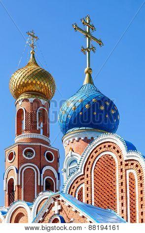 Cupolas Of Russian Orthodox Church Against Blue Sky