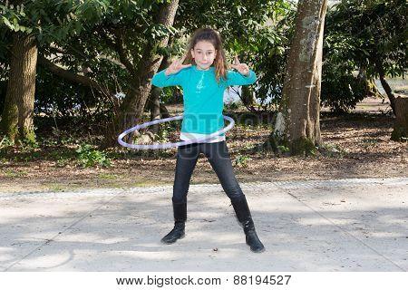 Girl Ten Years Playing Hula Hoops