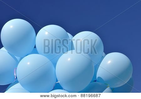 Blue Balloons On Blue Sky Background