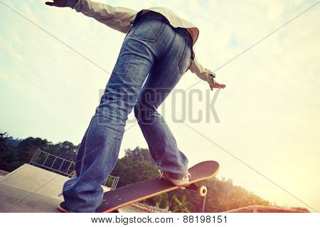 young skateboarder skateboarding at skatepark