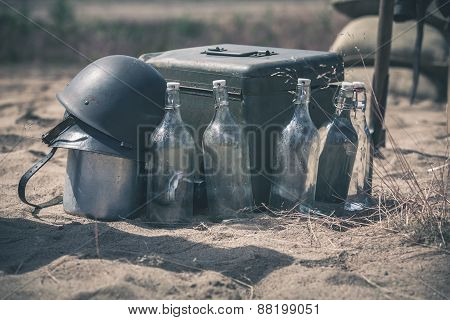 Soldier helmet with ammo box and empty bottles