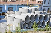 stock photo of septic  - Concrete circle pit and pipe block on factory yard - JPG