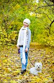 pic of west highland white terrier  - girl with west highland terrier in the park - JPG