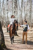 pic of brown horse  - romantic walk of bride and groom woman riding brown horse - JPG
