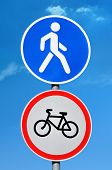 pic of bans  - Road sign permission for pedestrians and bicycle ban on blue sky background - JPG