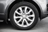 pic of alloy  - Modern automotive wheel on gray light alloy disc - JPG