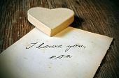 picture of i love you mom  - a cardboard heart and and old sheet of paper with the tex I love you - JPG