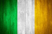 picture of irish flag  - Ireland flag or Irish banner on wooden boards background - JPG