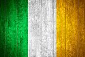 picture of irish flag  - Ireland flag or Irish banner on wooden boards background - JPG