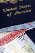 stock photo of passport template  - a close up of an immigrant visa and us passport - JPG