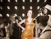 pic of superstars  - Superstar woman wearing golden shining dress posing to paparazzi - JPG