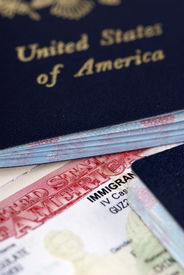 foto of passport template  - a close up of an immigrant visa and us passport - JPG
