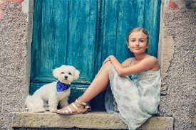 picture of maltese  - Portrait of fashion girl with Maltese dog - JPG