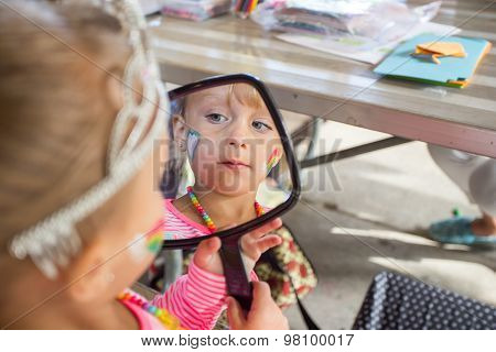 Little Girl Looking Into Mirror.