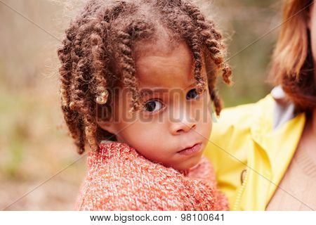 Portrait Of Girl On Walk In Forest With Mother