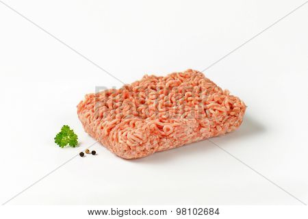 block of raw minced meat on white background