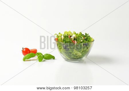 bowl of fresh vegetable salad on white background