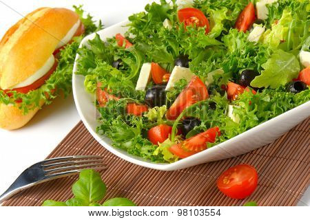 close up of vegetable salad and bun sandwich
