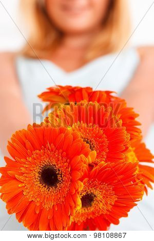 Close up of flowers held by woman