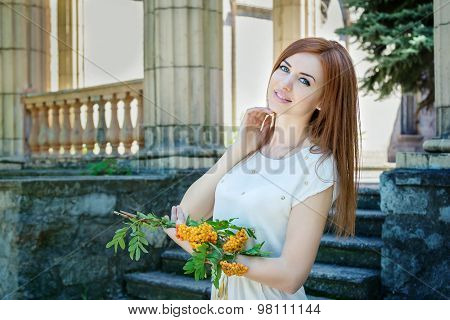 Woman with rowan branches
