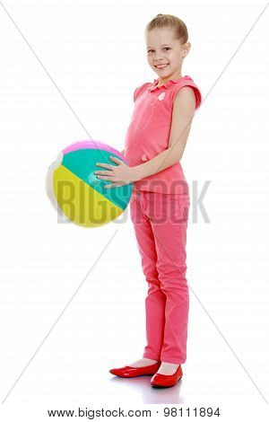 Girl holding a ball