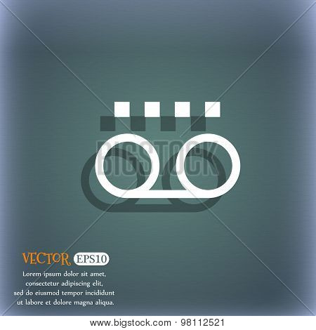 Audio Cassette Icon Symbol On The Blue-green Abstract Background With Shadow And Space For Your Text