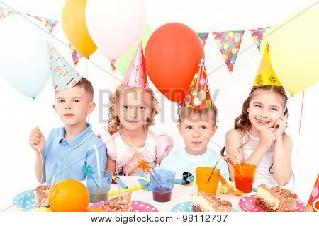 Little happy children with colorful balloons