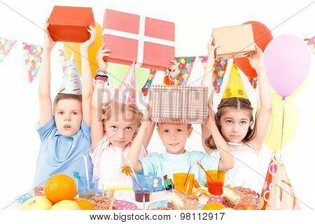 Little children posing with birthday presents