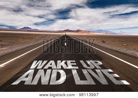 Wake Up and Live written on desert road