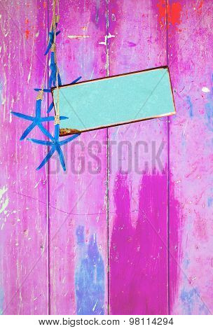 Blue starfish and space on pink