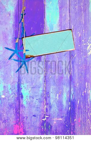 Blue starfish and space on purple