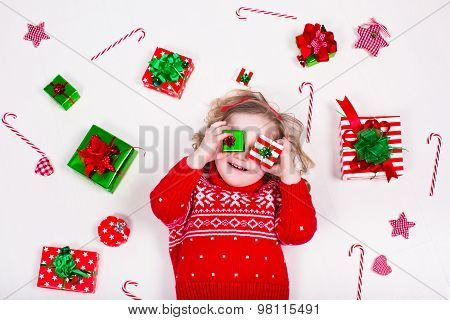 Little Girl Opening Christmas Presents
