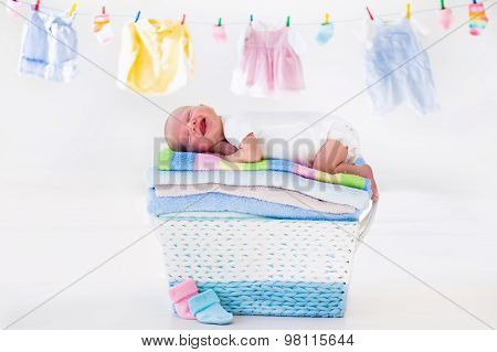 Newborn Baby In A Basket With Towels