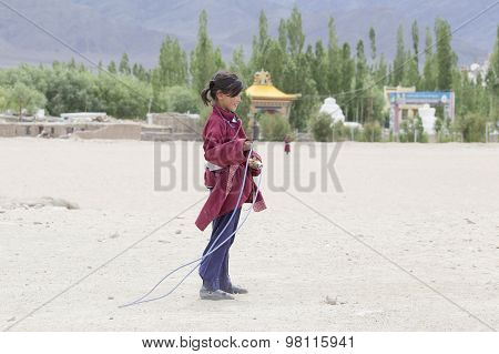 Tibetan Girl Jumping On A Skipping Rope In Druk White Lotus School. Ladakh, India