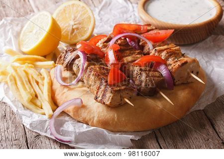 Greek Souvlaki Kebab With Pita And Vegetables Close-up Horizontal