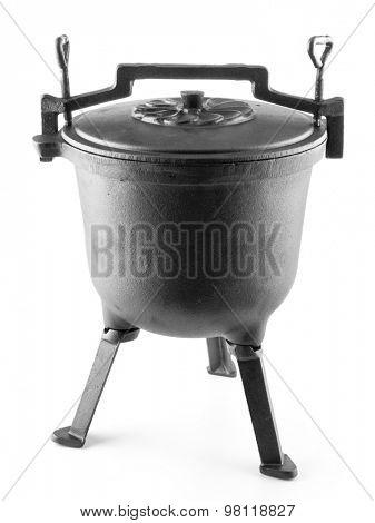 Black cast-iron kettle shot on white background