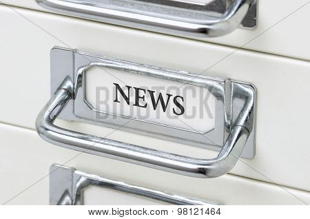 A Drawer Cabinet With The Label News