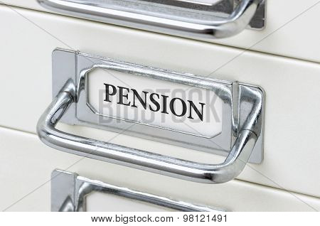 A Drawer Cabinet With The Label Pension