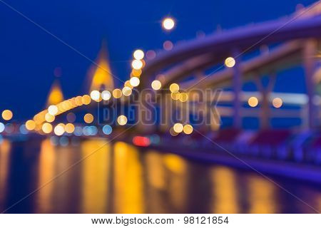 Blurred bokeh light background, with suspension bridge