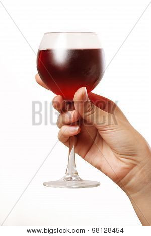 Glass With Red Wine In A Female Hand