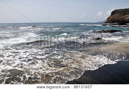 Waves Rolling Into Beach On An Islet