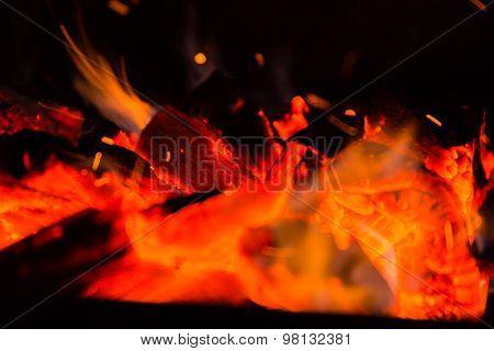 Fire, red-hot coals. Beautiful background.