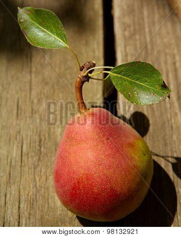 Fresh organic pear on old wood.