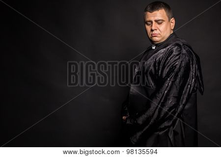 Chorno white photography priest on a dark background.