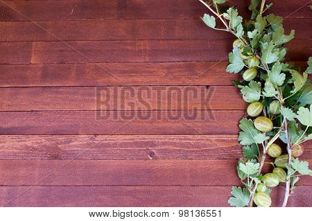 Fresh Berries Of Red And Green Gooseberries With Leaves On The Old Wooden Table With Copy Space