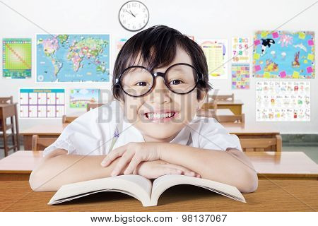 Child With Cute Face Smiling In The Classroom